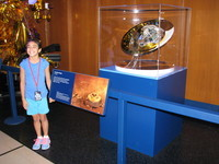 A 1:4 scale model of Huygens; judging by her enthuiasm, this girl might be a serious space geek and future JPL star.