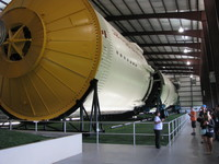 People for size next to the second stage (S-II).