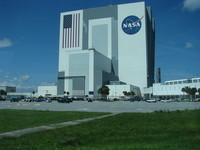 The single-story Vehicle Assembly Building with cars for scale.
