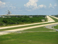 View onto Launch Complex 39(A?) with structures from the Space Shuttle era. I vividly remember the first time I saw these memorable structures (on LC-39B) during and after the Space Shuttle Discovery's STS-26 Return to Flight launch in 1988, which I taped and followed as a child.