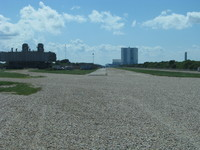 View down the crawlerway that goes between the VAB and launch complexes 39A/39B.