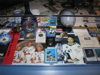 Apollo 11 memorabilia. The big photo to the lower left is noteworthy in that it includes Neil Armstrong's signature. However, Aldrin already signed with the Buzz Aldrin he also used in all of his later autographs, distinct from his Edwin E. Aldrin, Jr. signature on the plaque left on the Moon.