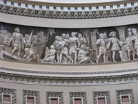 The magnificent Frieze of American History in the United States Capitol Rotunda. The figures, which are painted with only white, black and brown paint on a flat background, look unbelievable three-dimensional (a technique that's apparently called trompe-l'œil).