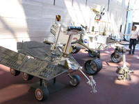 Replica of a Mars Exploration Rover and its successor, the Mars Science Laboratory.