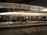 The Wright Flyer, with original wooden parts, the first successful heavier-than-air aircraft. This very plane took the Wright Brothers on their pioneering flight near Kitty Hawk in 1903.