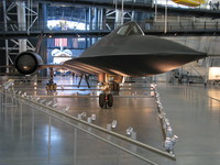 The Udvar-Hazy center's SR-71 Blackbird from up close, with the Space Shuttle Discovery in the background.