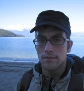 Me on the shores of Lake Manapouri, near Motorua Hut - check out my new glasses and cap!