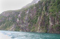 Steep fiord slopes formed by glaciers, at Milford Sound.