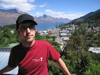 Me in Queenstown, by now having acquired more hair and still wearing my new cap and glasses.