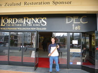 Me in front of Embassy Theatre, with two newly bought Lord of the Rings posters and tickets for tonight's show of the first part.