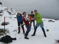 Snowfight posing on Mt Isobel, with a huge icicle and a fire extinguisher!